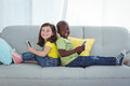 Smiling girl and boy using mobile phones Royalty Free Stock Photo