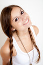 Smiling girl with braids looking at camera on white background Royalty Free Stock Photography