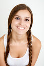 Smiling girl with braids looking at camera on white background Royalty Free Stock Images