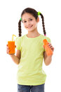 Smiling girl with carrot and glass of juice in hands isolated on white Royalty Free Stock Photography