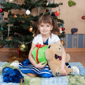 Smiling girl with christmas gifts at christmas tree (6 years) Royalty Free Stock Photo