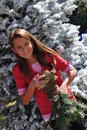 Smiling girl in Christmas tree lot Royalty Free Stock Image