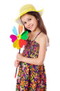 Smiling girl with colorful windmill Royalty Free Stock Photo