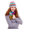 Smiling girl with cup of tea young woman in warm dress colorful scarf and cap hot green isolated on white background mask included Stock Photo