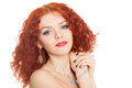 Smiling girl with curly red hair isolated on white Royalty Free Stock Photo