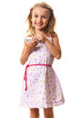 Smiling girl dialing smartphone cute little blond touching the display playing or using isolated on white Royalty Free Stock Photo