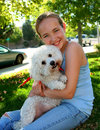 Smiling girl with dog Royalty Free Stock Photo