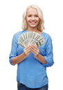 Smiling girl with dollar cash money finances and people concept Stock Photography