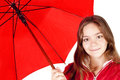 Smiling girl dressed in raincoat holding umbrella Royalty Free Stock Image