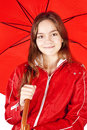 Smiling girl dressed in raincoat holding umbrella Royalty Free Stock Photos