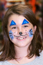Smiling girl easter hunt party her face painted as blue easter bunny rabbit Stock Photo