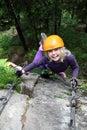 Smiling girl enjoy climbing