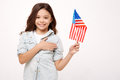 Smiling girl expressing love to her nation in the studio Royalty Free Stock Photo
