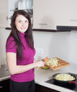 Smiling girl frying eggplant in griddle at kitchen Stock Photography