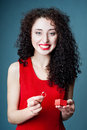Smiling girl getting out a ring from a red gift box Royalty Free Stock Photography
