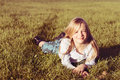 Smiling girl in grass young lying down Royalty Free Stock Images