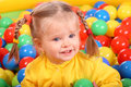 Smiling girl. Group of color ball back Royalty Free Stock Photo
