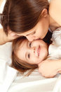 Smiling girl a happy family young woman and little in bed Royalty Free Stock Photos