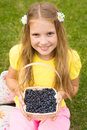Smiling girl holding basket with berry Royalty Free Stock Photo