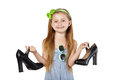 Smiling girl holding big black mother shoes Royalty Free Stock Photo