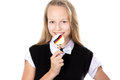 Smiling girl holding candy with germany flag portrait of happy cute beautiful blond wearing black formal outfit bowtie lollipop Stock Photo
