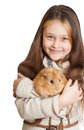 Smiling girl holding a guinea pig on white background isolated Royalty Free Stock Image