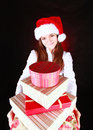 Smiling girl holding presents over dark Royalty Free Stock Images