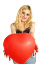 The smiling girl holding a red inflatable ball isolated on white Royalty Free Stock Photography