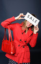 Smiling girl holding sale sign Stock Photo