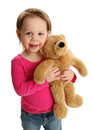 Smiling girl holding teddy bear happy little a soft Royalty Free Stock Photography