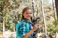 Smiling girl holding a water bottle in the forest Royalty Free Stock Photo