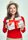 Smiling girl holding white gift box.