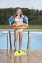 Smiling Girl With Inflatable Ring And Fins Against Pool Royalty Free Stock Photo