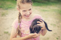 Smiling girl with kitten Royalty Free Stock Photo