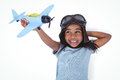 Smiling girl laying on the floor playing with toy airplane Royalty Free Stock Photo