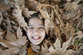 Smiling girl in the leaves Royalty Free Stock Photo