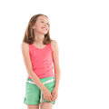 Smiling girl looking away three quarter length studio shot isolated on white Stock Photography