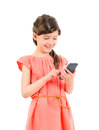 Smiling girl with mobile phone little cute in red dress playing on smartphone isolated on white background Royalty Free Stock Photos