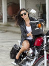 Smiling girl on a motorcycle Royalty Free Stock Photo