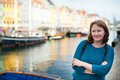 Smiling girl in nyhavn copenhagen denmark Royalty Free Stock Image