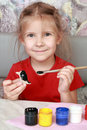 Smiling girl paints crafts Royalty Free Stock Photos