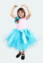 Smiling girl performing in tutu skirt studio shot Royalty Free Stock Photography