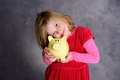 Smiling girl with piggy bank Royalty Free Stock Photo
