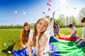 Smiling girl playing with friends in the park Royalty Free Stock Photo