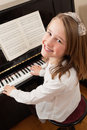 Smiling girl playing her piano Royalty Free Stock Images