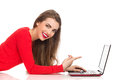 Smiling girl pointing at a laptop Royalty Free Stock Photo