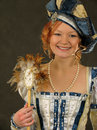 Smiling Girl in Polish clothes of 16 century with mirror-fan Royalty Free Stock Photography