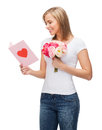 Smiling girl with postcard and bouquet of flowers love holidays happiness concept lowers Stock Images