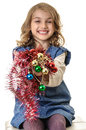 Smiling girl presenting beautiful christmas decorations little with in hands isolated on white Royalty Free Stock Images