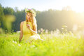 Smiling girl relaxing on green meadow Royalty Free Stock Photo